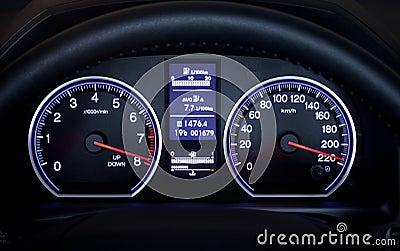 Illuminated car dashboard.