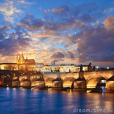 Free Illuminated Charles Bridge Is Reflected In Vltava River Early In Royalty Free Stock Images - 107855629