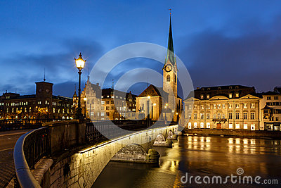 Illuminated Fraumunster Church and River Limmat