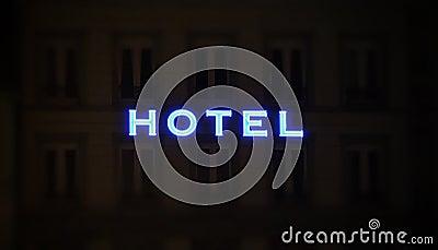 Illuminated hotel sign taken at night