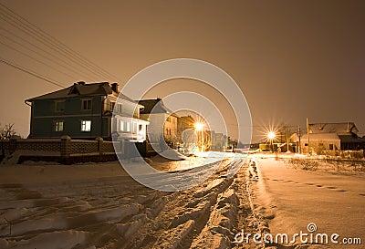 Illuminated house at winter