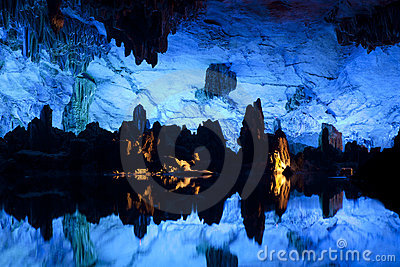 Illuminated Lake in Cave