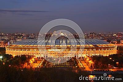 Illuminated Luzhniki Stadium at evening