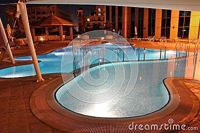 Illuminated poolside at night