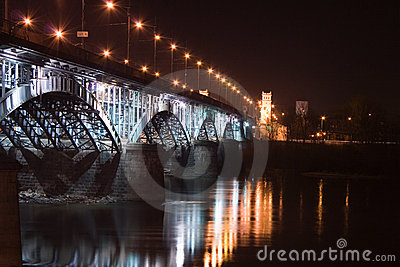 Illuminated railway bridge in Warsaw ( Poland)