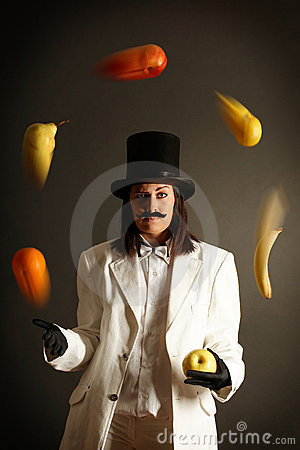 Illusionist juggling with fruits