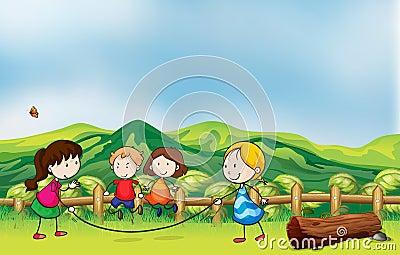 Kids playing jumping rope at the bridge