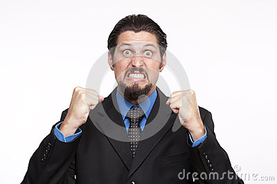 Image of a angry young businessman with clenched fist