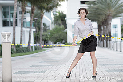 Image of a businesswoman pulling on a rope