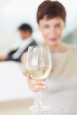Image of a female offering a glass of champagne