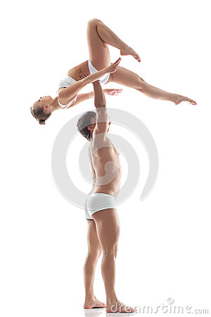 Image of graceful acrobats - strong man holds girl