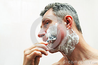 Image of man shaving