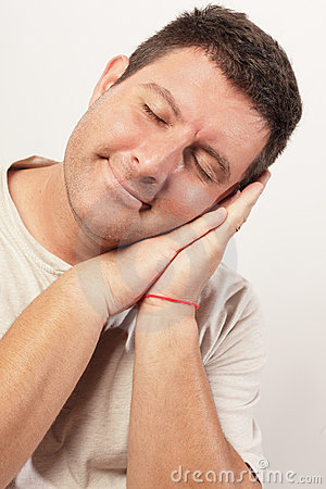 Image of a man sleeping and smiling
