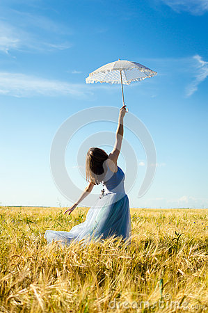 Free Image Of Beautiful Blond Young Woman Wearing Long Blue Ball Dress And Holding White Lace Umbrella Leaning Up On Wheat Field Stock Photography - 42189482