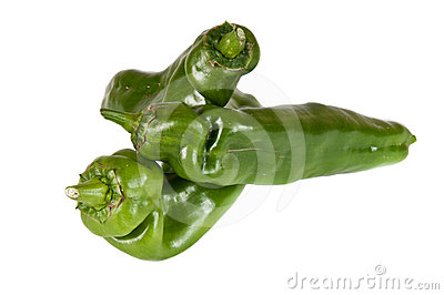 Image of a pile of organic green peppers over a wh