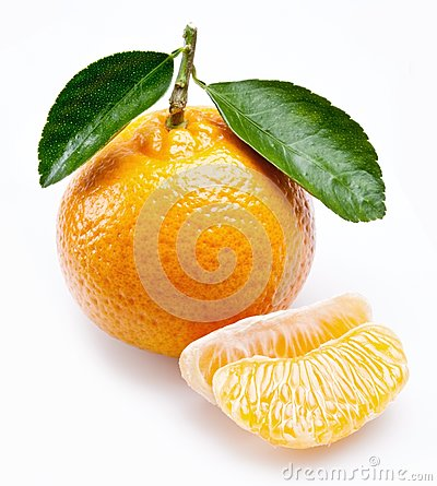 Image of a ripe tangerine with leaves on white