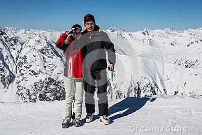 Two skiers on a break