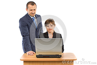 Image of two working people