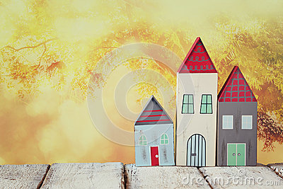 Image of vintage wooden colorful houses decoration on wooden table in front of blurred background