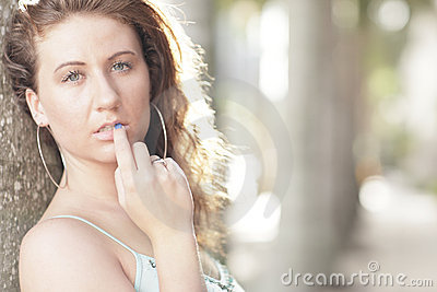 Image of a woman with her fingers on her lips