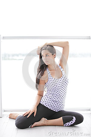 Image of a woman in a yoga pose