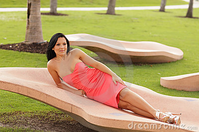 Image of a young woman laying in the park