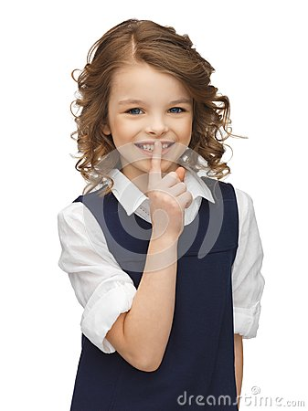 Menina Pre-adolescente que mostra o gesto do hush