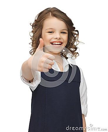 Muchacha Pre-adolescente que muestra los pulgares para arriba
