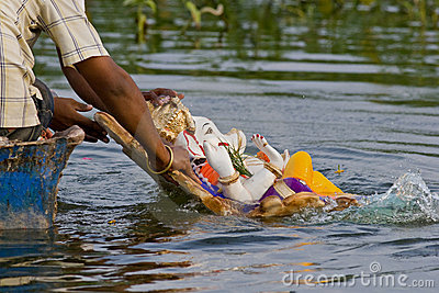 Immersing lord Ganesha idol in the river