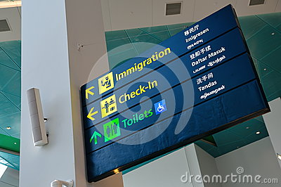 Immigration, check-in and toilet signs