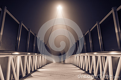 Misty bridge at night
