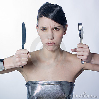 Impatient class woman with silver knife and fork