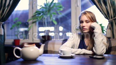 Impatient girl waiting for her boyfriend in cafe stock footage