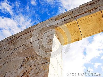 Imposing brick wall and sky