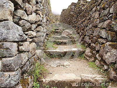 Inca trail between stone walls