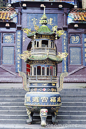 A incense burner in front of temple