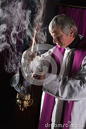 Incense burner and priest