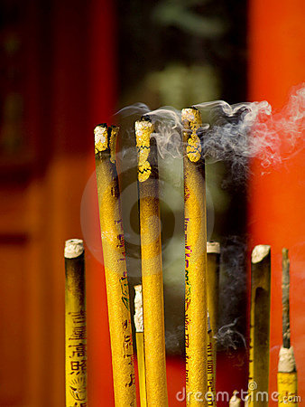 Incense and candle in temple