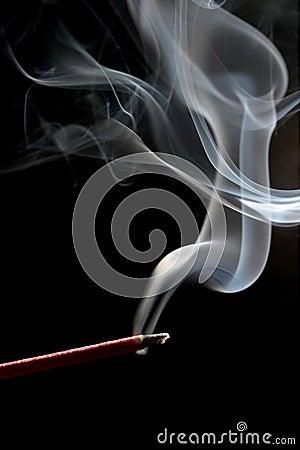 Incense over black