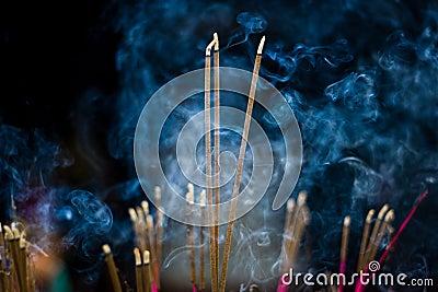 Incense sticks with blue smoke
