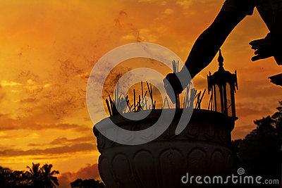 Incense on sunset background