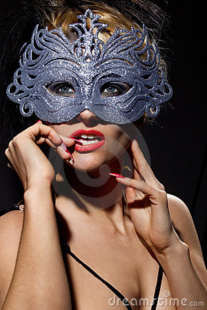 Incognito woman in ancient style mask