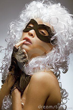 Incognito woman in ancient wig and mask