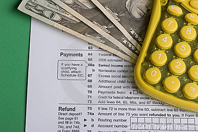 Income tax form with calculator and money