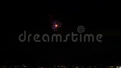 Incredible japanese firework bright light colorful explosion in dark night sky over big city in 4k dark background shot. Incredible japanese firework bright stock footage