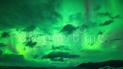 Incredible 4k time lapse shot of bright neon green northern lights aurora borealis glowing in dark polar night sky. Incredible time lapse shot of bright neon stock video footage