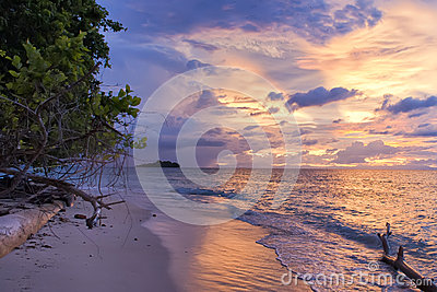Incredible sunset on wonderful Turquoise Tropical Paradise Beach