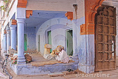 India man near the blue house Editorial Stock Image