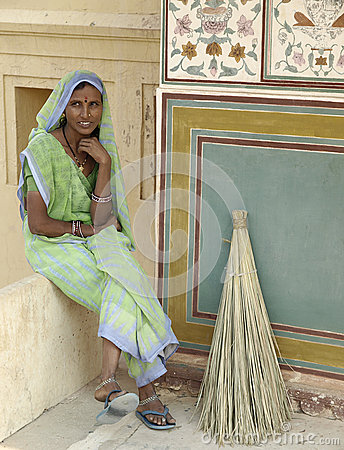 India woman have rest while sweeping Editorial Photography