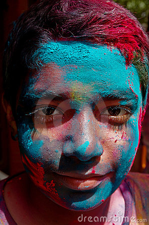 Indian boy covered with paint